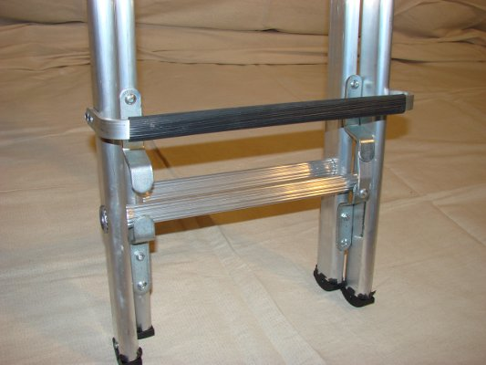 Base of two section extendable industrial roof ladder